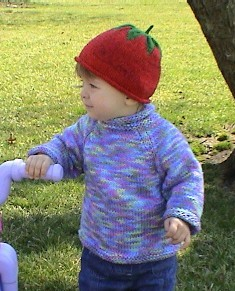 multicolor sweater and hat